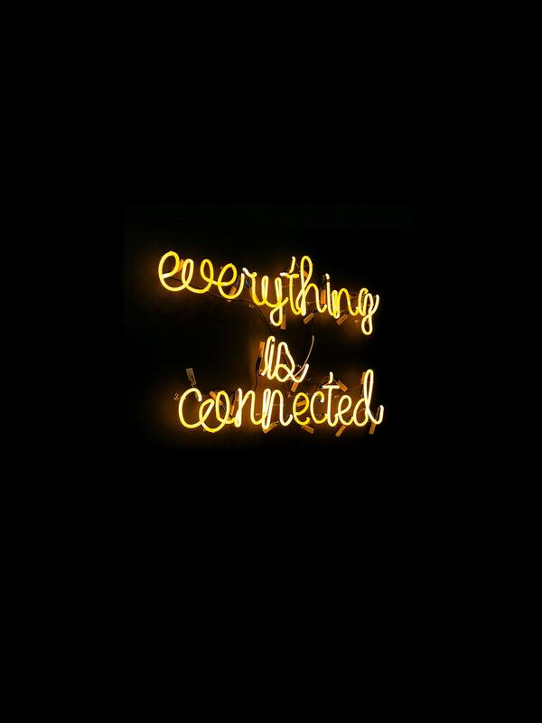 Everything is connected neon light signage on a plain black background